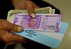 印地安货币和银行存折 免版税库存照片