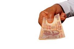 印地安货币钞票INR 10在手上 免版税图库摄影