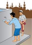 印度尼西亚回教男性洗涤的手 免版税库存照片
