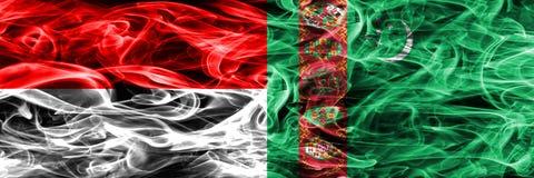 印度尼西亚对土库曼斯坦肩并肩被安置的烟旗子 浓厚 皇族释放例证
