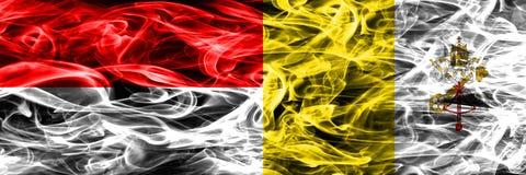 印度尼西亚对梵蒂冈肩并肩被安置的烟旗子 浓厚 皇族释放例证