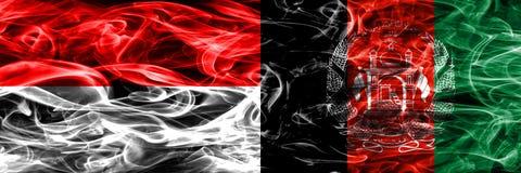 印度尼西亚对阿富汗肩并肩被安置的烟旗子 浓厚 免版税库存照片