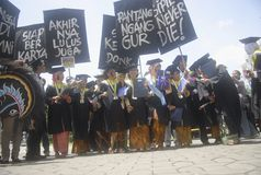 印度尼西亚需要更多博士学位讲师 免版税库存照片