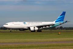印度尼西亚鹰航空公司空中客车A330-243 免版税库存图片