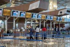 印度尼西亚鹰航空公司航空公司登记处柜台在雅加达Soekarno哈达国际机场 免版税库存照片