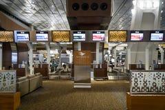 印度尼西亚鹰航空公司航空公司登记处柜台在雅加达Soekarno哈达国际机场 库存图片