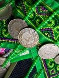 在小山部落装饰的印度支那法国硬币 免版税库存照片