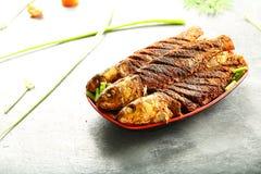 印度海鲜食谱油煎了鱼用异乎寻常的香料 图库摄影