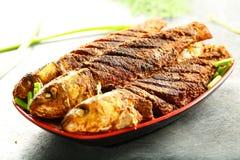 印度海鲜食谱油煎了鱼用异乎寻常的香料 免版税库存图片