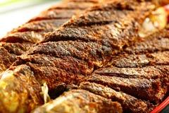 印度海鲜食谱油煎了鱼用异乎寻常的香料 免版税库存照片