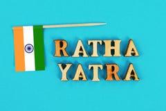 印度的旗子和Ratha yatra文本  普里Jagannath Ratha Jatra往返旅行叫作Bahuda Jatra 免版税库存照片