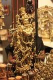 印第安上帝阁下Krishna Handicraft Gold Idol 免版税库存照片