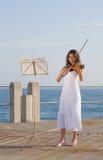 印第安作用小提琴妇女 库存照片