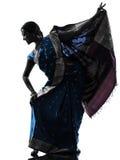 印第安妇女舞蹈演员跳舞剪影 免版税库存照片