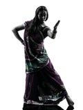 印第安妇女舞蹈演员跳舞剪影 免版税图库摄影