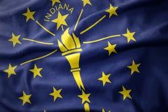 印第安纳状态挥动的五颜六色的旗子  免版税图库摄影
