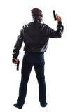 危及人在他的手上的拿着枪 图库摄影