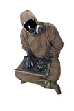 危险衣服的人与膝上型计算机 免版税图库摄影