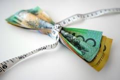卷尺紧紧包裹澳大利亚钞票 免版税库存图片