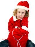 卷曲小的圣诞老人 免版税图库摄影