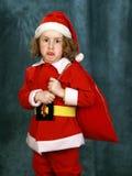 卷曲小的圣诞老人 免版税库存图片