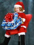 卷曲小的圣诞老人 免版税库存照片
