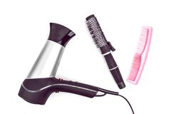 卷毛、梳子和Hairdryer的发刷 免版税库存照片