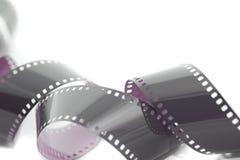 卷起的被展开的被暴露的35mm影片小条 免版税库存照片