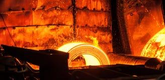 卷高热金属在传送带 免版税库存图片