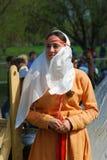 历史服装微笑的妇女 免版税库存照片