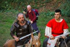 历史的服装的人们在斯皮兰贝尔托集会,意大利公园  图库摄影