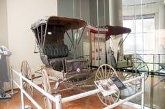历史的用马拉的儿童车 免版税库存照片