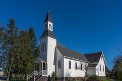 历史的米尔纳教堂在Langely不列颠哥伦比亚省在清楚的蓝天下 免版税库存照片