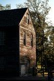 历史的锯木厂木大厦在老村庄 库存照片