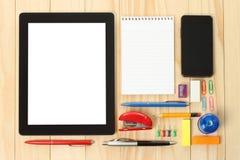 压片个人计算机和巧妙的电话有学校办公室供应的 免版税库存图片