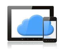 压片个人计算机和巧妙的电话有蓝色云彩的 图库摄影