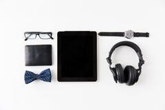 压片个人计算机,有行家个人材料的耳机 免版税库存图片