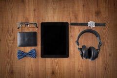 压片个人计算机,有行家个人材料的耳机 库存照片