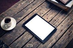 压片在桌上的计算机与咖啡 免版税图库摄影