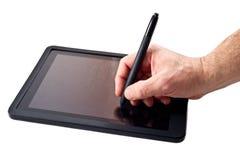 片剂个人计算机和笔 库存照片
