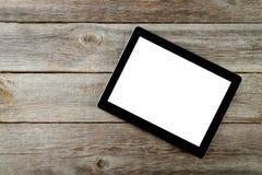 压片有白色屏幕的计算机在灰色木背景 库存照片