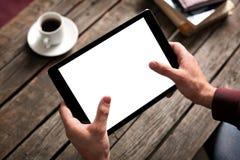 压片有被隔绝的屏幕的计算机在男性手上 库存照片