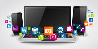 压片计算机和手机有五颜六色的应用象的 免版税库存图片
