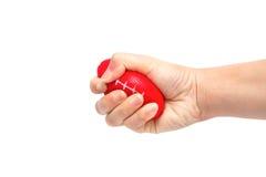 紧压重音球的妇女手 库存图片