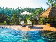巴厘岛,印度尼西亚- 2014年4月14日:游泳池看法在Nandini密林手段和温泉的 库存图片