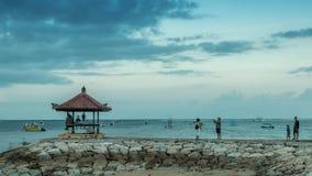 巴厘岛,印度尼西亚- 2017年6月22日:热带海滩萨努尔,巴厘岛,印度尼西亚时间间隔  4K Susnset时间 影视素材