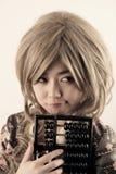 厚颜无耻的亚裔女孩 免版税库存图片