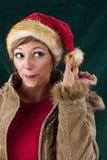 厚颜无耻的女性圣诞老人 免版税图库摄影