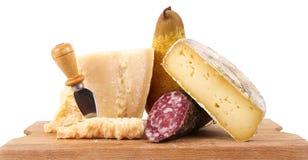 原始的意大利食物专业在白色背景中 库存照片