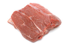 原始的牛肉部分在白色的 库存照片